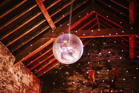 Glitterball in the rustic stone barn wedding venue